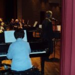 Photograph of Alison playing piano